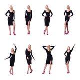 La femme dans la robe noire dans le concept de mode sur le blanc Photos libres de droits