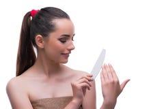 La femme dans le concept de beauté avec le dossier de clou Image stock