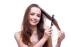 La femme dans le concept de beauté peignant des cheveux photos libres de droits