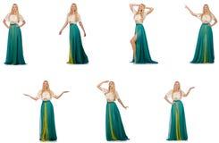 La femme dans le concept de mode dans la robe verte sur le blanc Photos stock