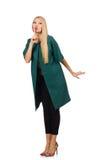 La femme dans le manteau vert d'isolement sur le blanc Photographie stock