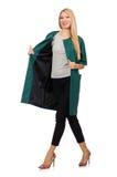 La femme dans le manteau vert d'isolement sur le blanc Photos stock