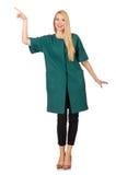 La femme dans le manteau vert d'isolement sur le blanc Images stock