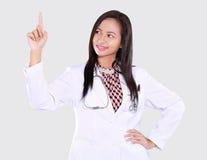 La femme de docteur se dirige vers le haut Images libres de droits