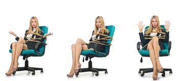 La femme de femme d'affaires attachée avec la corde sur le blanc Image stock
