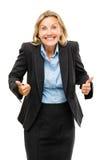 La femme heureuse d'affaires mûres manie maladroitement d'isolement sur le backgrou blanc Photos libres de droits