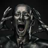 La femme nue aiment la statue en métal liquide Photos stock