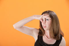 La femme pince son nez Photographie stock libre de droits