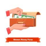 La femme remet sortir le billet de banque d'une bourse illustration libre de droits