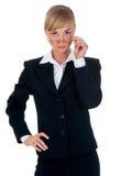 La femme s'est habillée dans un costume dans le studio Images libres de droits