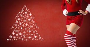 La femme sexy Santa et l'arbre de Noël de flocon de neige modèlent la forme image libre de droits