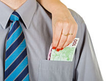 La femme sortent l'argent de la poche Photographie stock