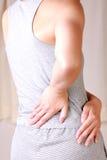 La femme souffre du lumbago Image stock
