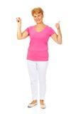 La femme supérieure montre le thermomètre et faire des gestes CORRECT Photo stock