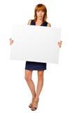 La femme tient une bannière Photographie stock libre de droits