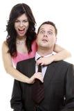 La femme tirant dessus équipe le lien, couple drôle Image libre de droits