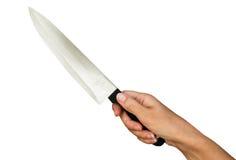 La femme utilise le couteau Photos stock
