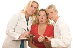 La femmina falsifica i vestiti medici pazienti Immagini Stock Libere da Diritti