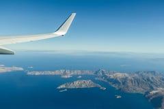 La fenêtre d'Aeral a tiré du Grec Telendos et de la partie d'îles de Kalymnos en mer Égée Photos stock