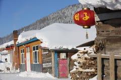 La ferme bimodale de forêt dans la province de Heilongjiang - village de neige Image libre de droits