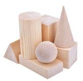 La figura de madera forma geométrica, aislada en blanco Fotos de archivo