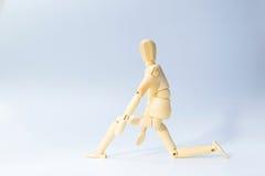 La figura de madera muñeca con se prepara para correr la emoción para comienza para arriba busi Imagen de archivo