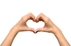 La figura del cuore si è formata con la mano della donna Fotografia Stock Libera da Diritti