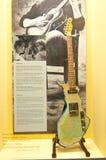 La figura della Finlandia gradice la chitarra di spremuta Leskinen Immagine Stock