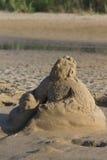 La figura della sabbia sulla spiaggia Fotografia Stock