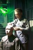 La figura di cera del barbiere della porcellana antica Fotografie Stock