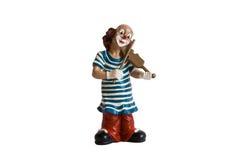 La figurine d'isolement du clown avec un violon Images stock