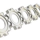 La fila de una rueda dentada adapta Foto de archivo libre de regalías