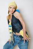 La fille à la mode dans des vêtements de jeans Photographie stock libre de droits