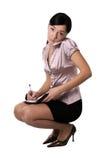 La fille écrit dans le journal Photo libre de droits