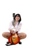 La fille aime une guitare Photographie stock