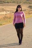 La fille allant sur la route Photos stock