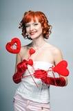 La fille avec des coeurs Image stock