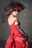 La fille avec du charme dans une belle robe Photo stock