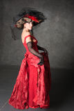 La fille avec du charme dans une belle robe Images stock