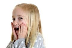 La fille avec l'expression étonnée a ses mains sur des joues Photo libre de droits