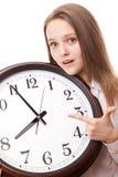 La fille avec l'horloge Photographie stock libre de droits