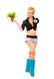 La fille avec la fleur dans le bac affichant des pouces lèvent le geste image libre de droits