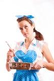 La fille avec la vaisselle de cuisine Photo libre de droits