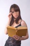 La fille avec le livre Photographie stock