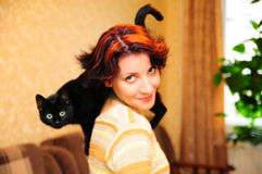 La fille avec un chat Photos libres de droits