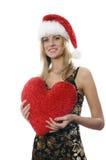 La fille avec un coeur de peluche Photographie stock