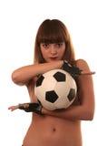 La fille avec un football Photographie stock