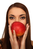La fille avec une pomme Image stock
