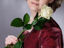 La fille avec une rose Photo libre de droits