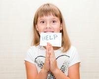 La fille a besoin de l'aide Photos libres de droits